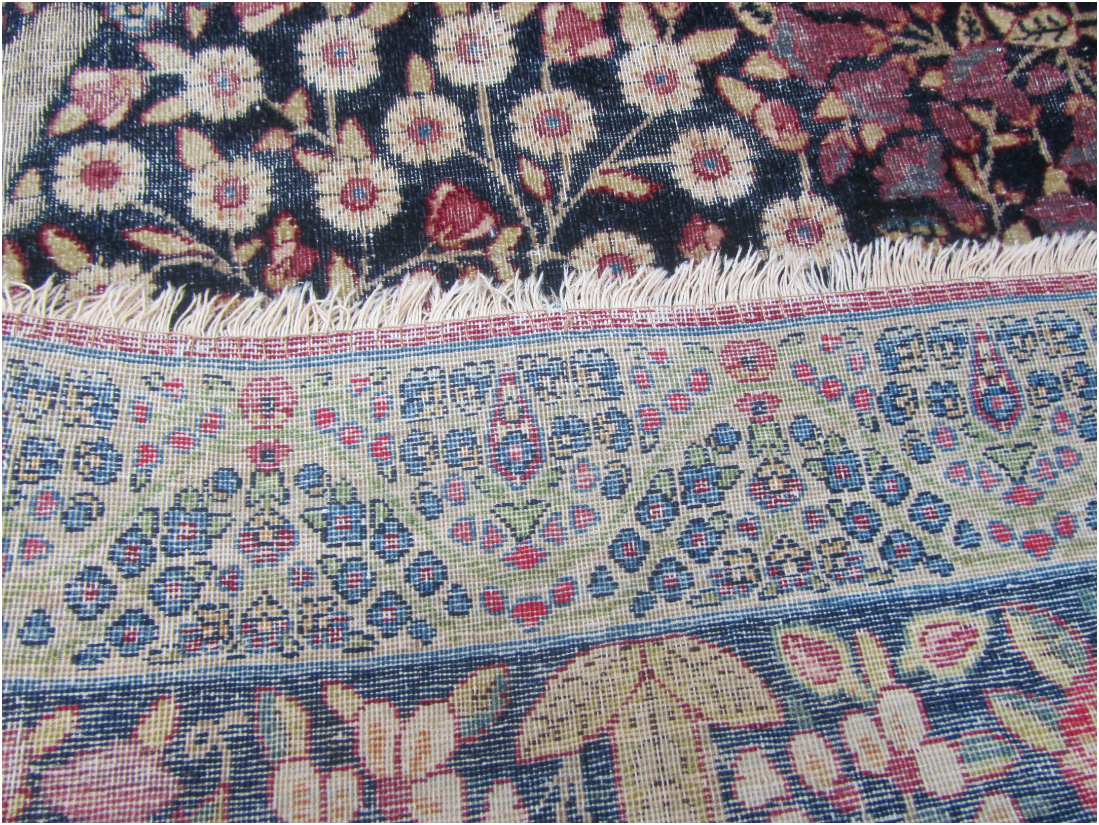 The back of the rug shows how finely knotted it is.