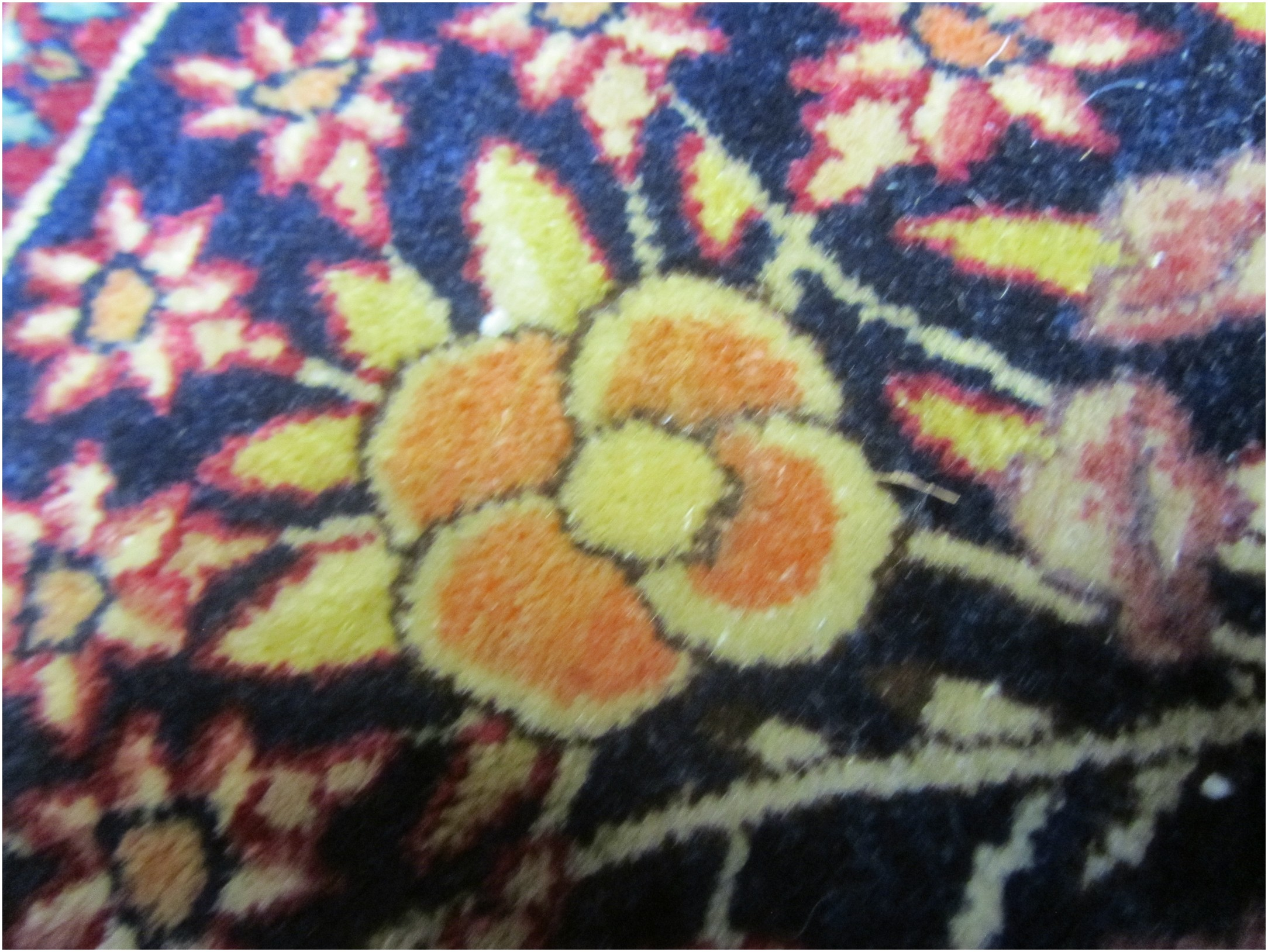 The yellow and pink pigments, like these, are seen in mostly very old Persian rugs.