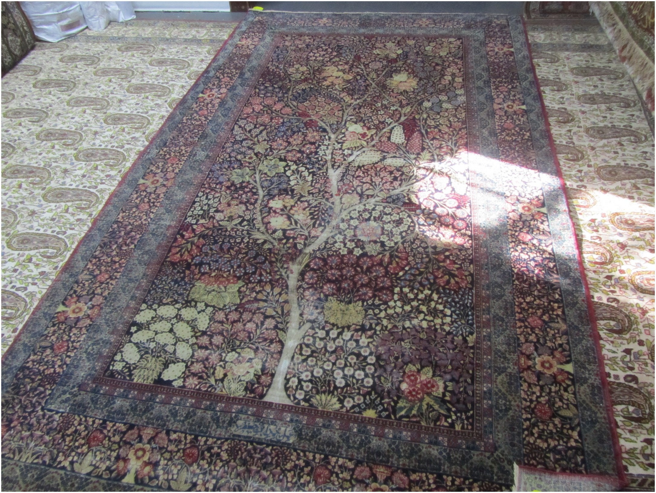 The rug measures five feet and two inches by nine feet.