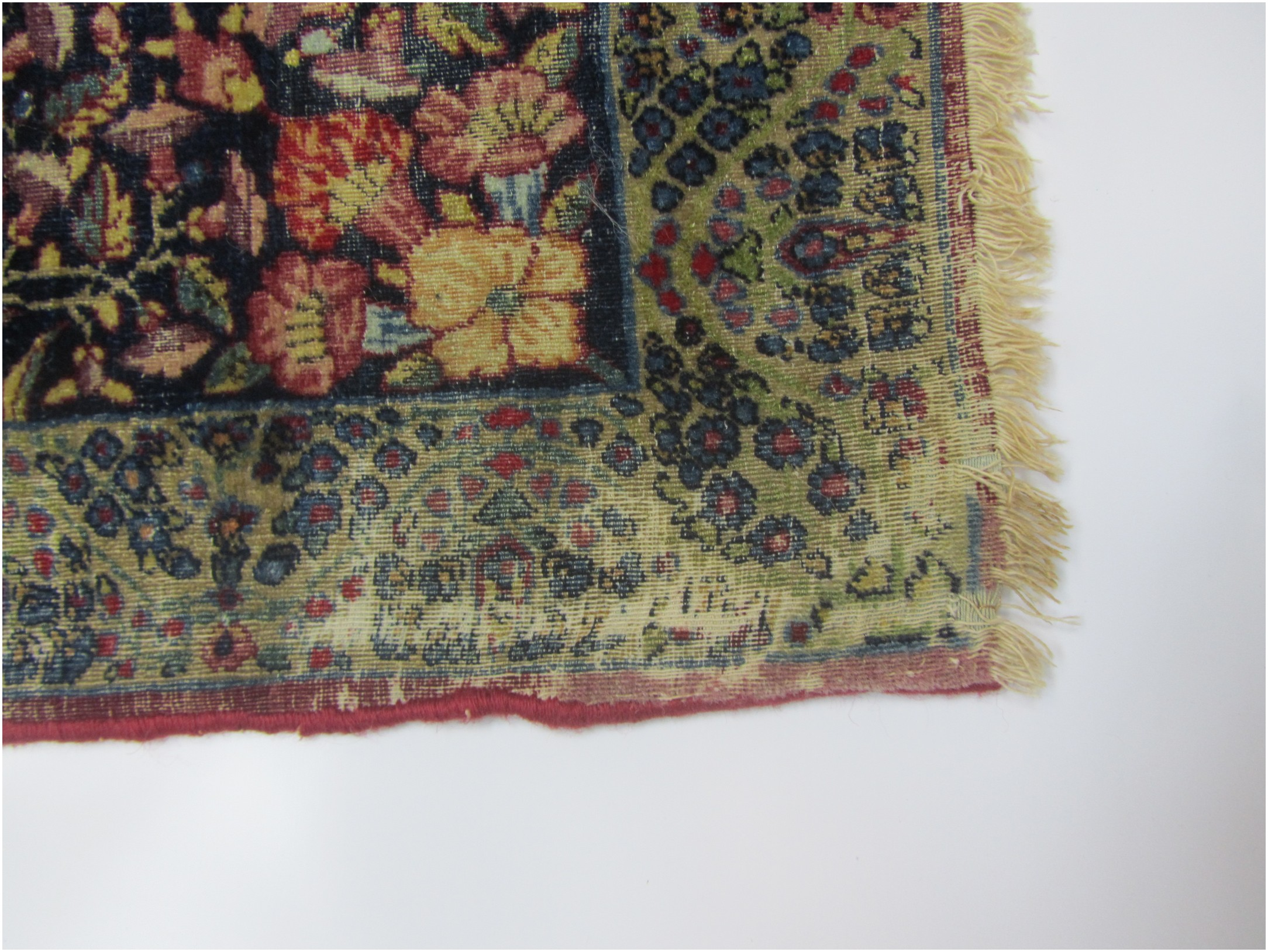 The fringe is damaged on both ends of the rug.