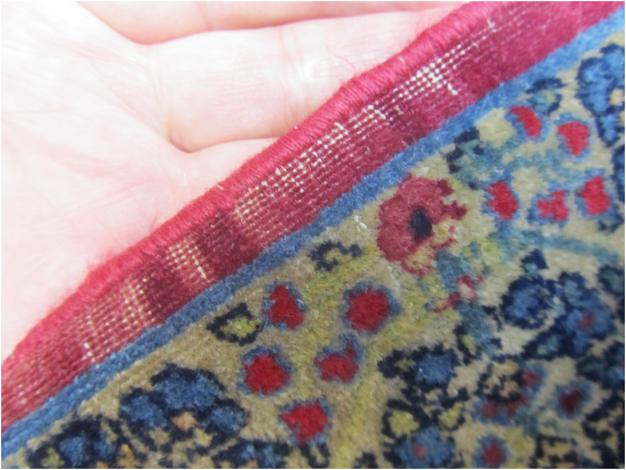 The edge in red shown here made by unmatched wool. You can see the shiny new wool