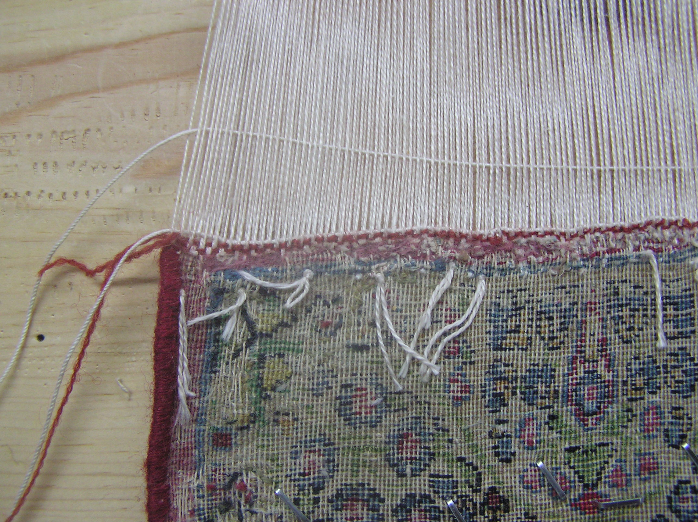The previous repair with red yarn is redone properly by sarbafi